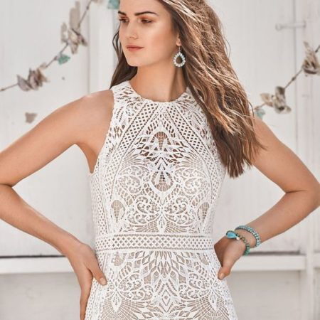 Bohemian bride in halter wedding dress with intricate lace designs