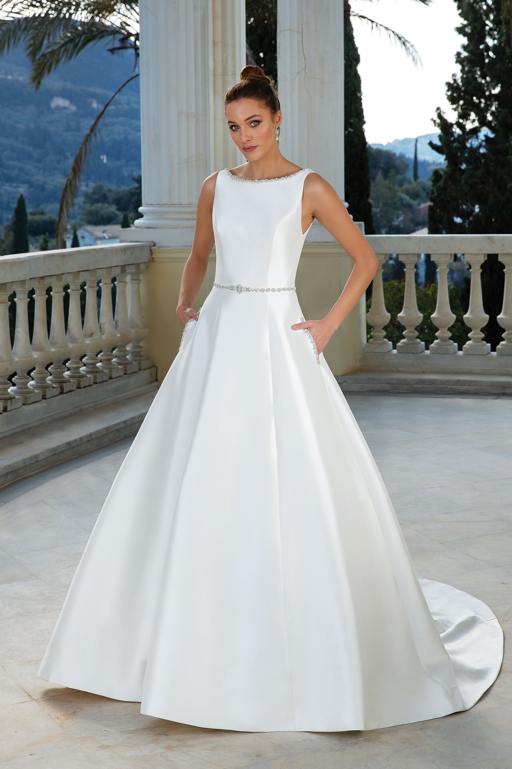 Wedding dress with sleeves and high neckline