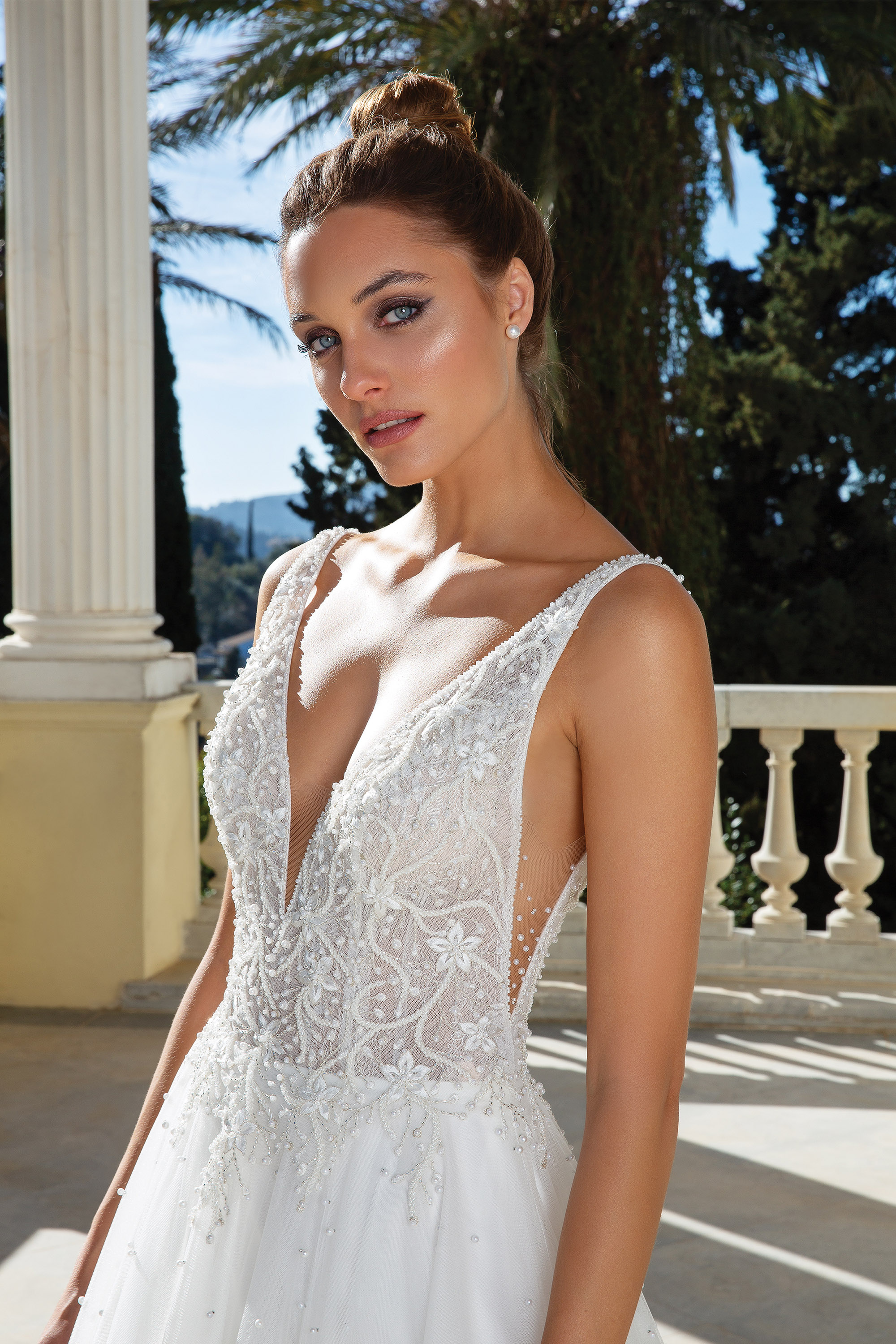 Embroidered, v-neck wedding dress from the waist up